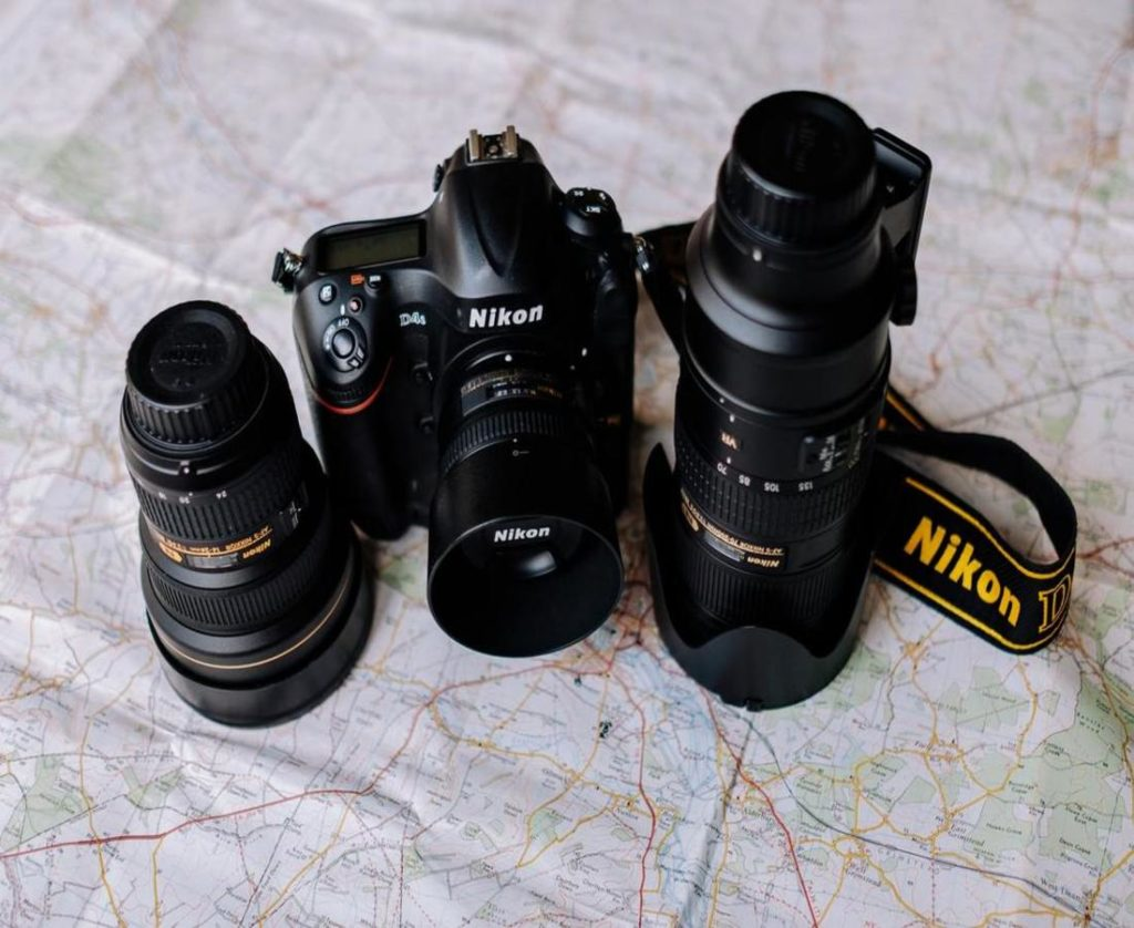Nikon lens with camera laying on table