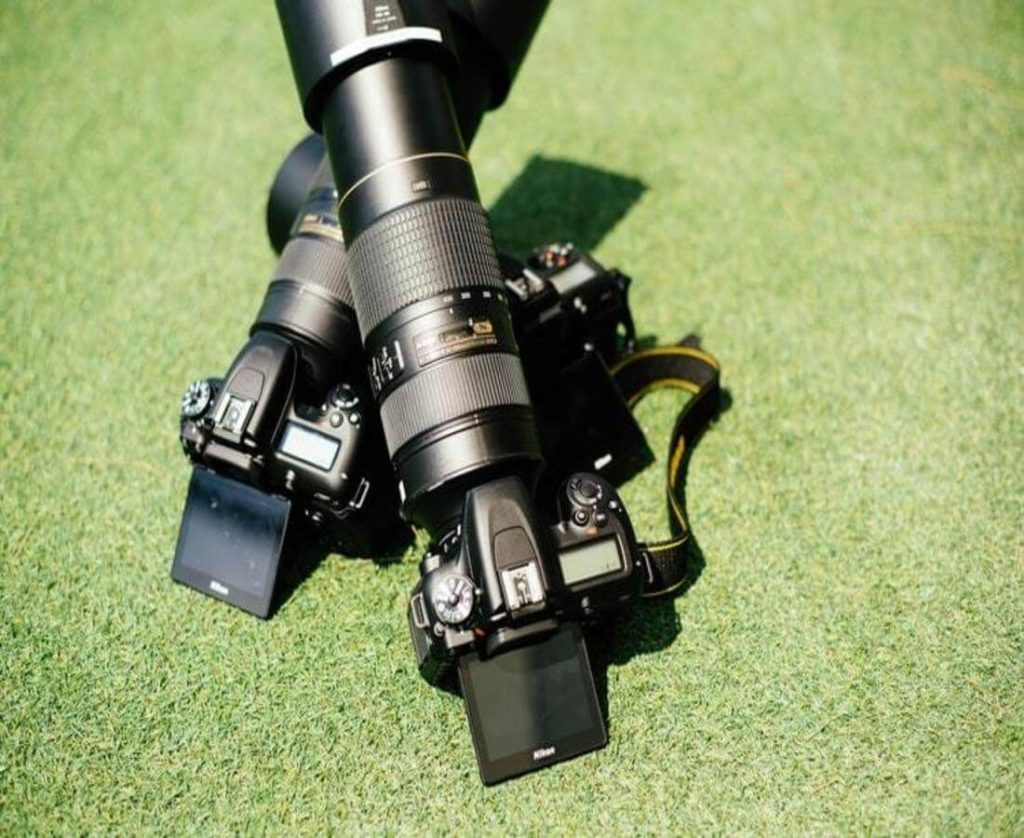 best Nikon lens laying on a green grass in a sports stadium